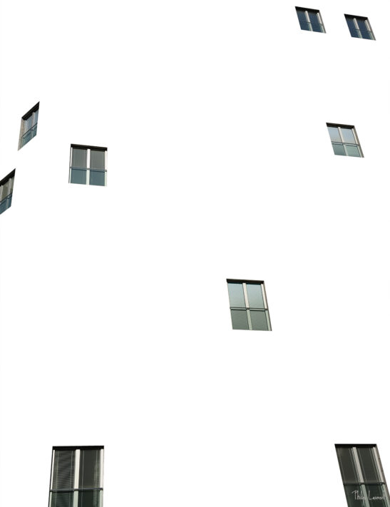 A photo showing windows in a building but the building is removed and filled with white space